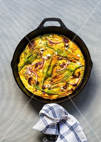 Frittata with courgette flowers, chorizo and cream cheese