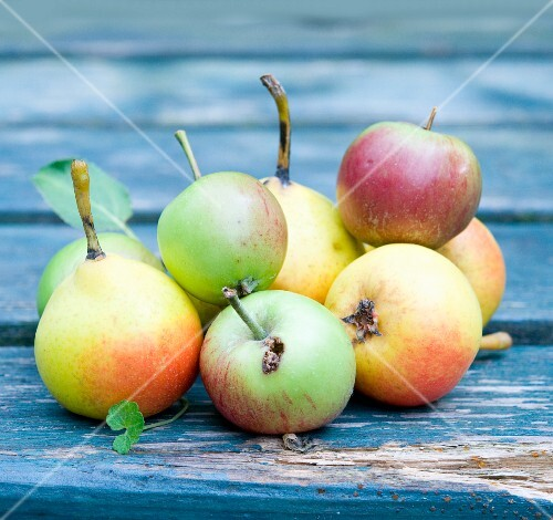 Apples and pears on a wooden table