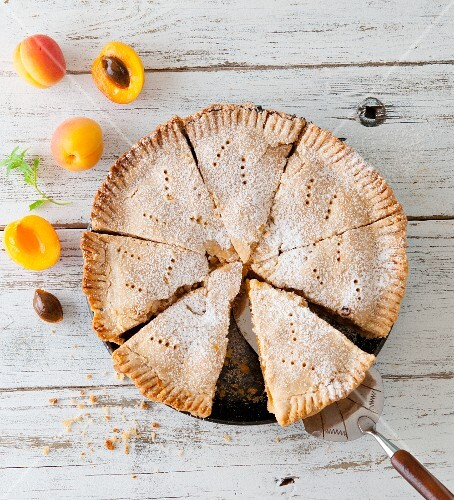 Sliced apricot pie with fresh apricots