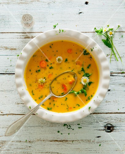 Carrot soup with daisies