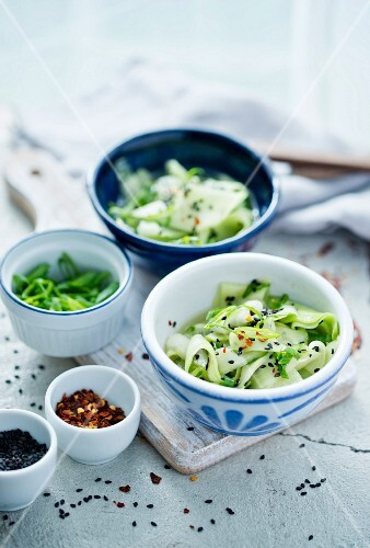 Cucumber salad with chilli flakes, spring onion and sesame seeds