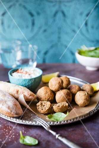 Home-made falafels with tzatziki (cucumber & yoghurt dip), spinach and pitta bread