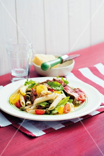 Penne pasta with fresh tomatoes and Angus steak
