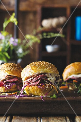 Sesame seed rolls with ox tongue, coleslaw and mustard sauce