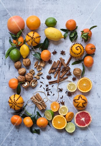 Assorted citrus fruits with nuts and spices
