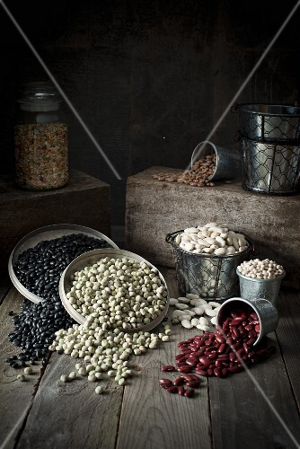 Assorted types of beans in containers