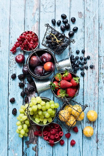 An arrangement of different types of fruit in metal containers