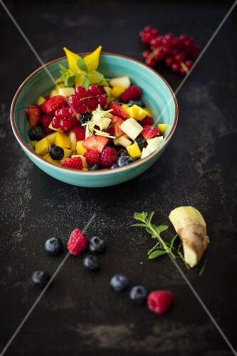 Colourful fruit salad with ginger