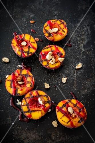 Grilled peaches wirh raspberry sauce