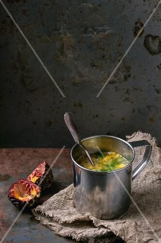 Kiwi & passionfruit smoothie in a metal mug
