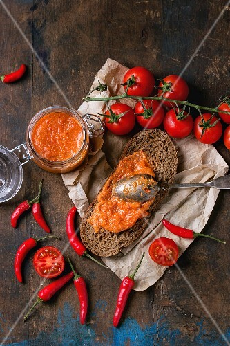 Home-made sauce made with tomato, red pepper, chili peppers and sheep's cheese in rye bread and in a glass