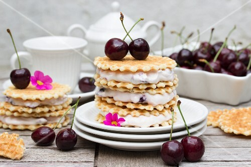 A waffle sandwich with cherries