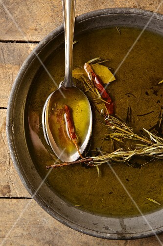 Olive oil infused with red chilli peppers, rosemary and bay leaf