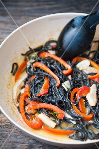 Black squid ink pasta with mushrooms and pepper