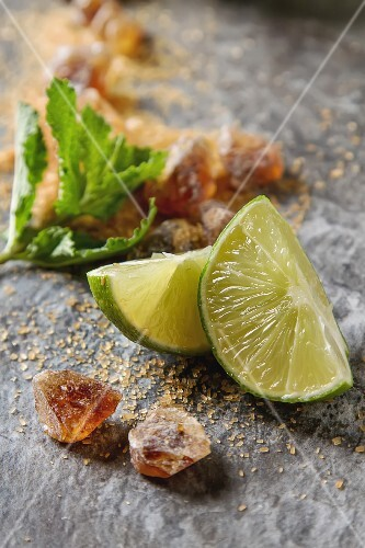 Ingredients for a mojito: fresh mint, limes and sugar