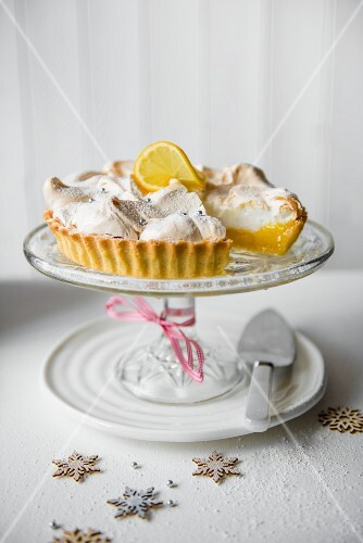 Lemon meringue pie on a glass cake stand for Christmas