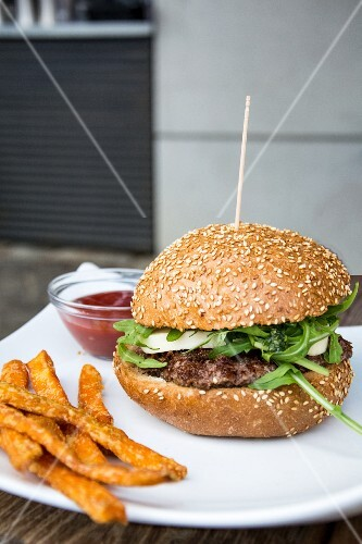 A burger with sweet potato chips