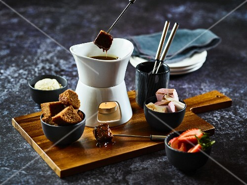 Fondue with assorted ingredients