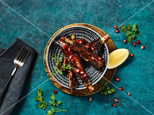 Lamb ribs with pomegranate seeds