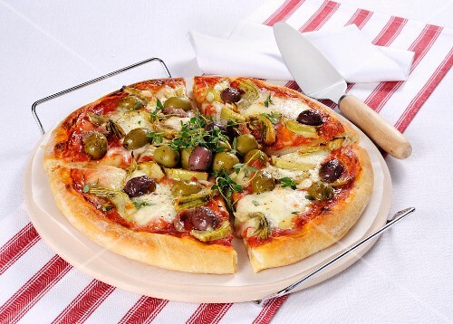 A pizza with olives and artichokes
