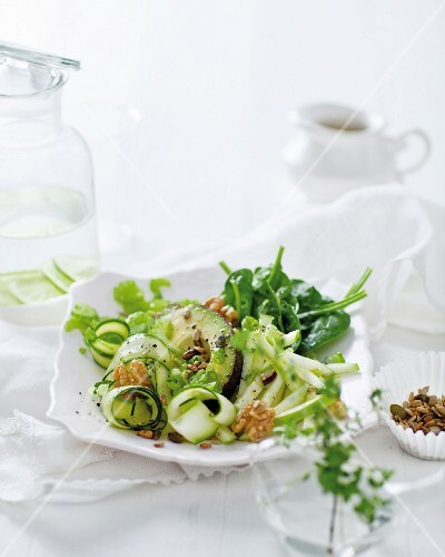A green superfood salad with spinach, cucumber, celery, avocado and apple