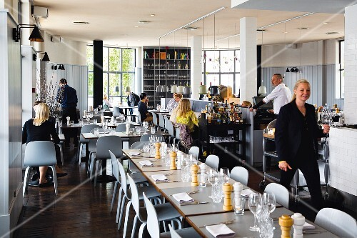 Staff and guests at the restaurant Almanak in Copenhagen, Denmark
