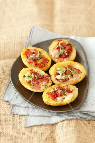 Baked potatoes filled with bacon and mozzerella