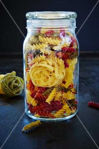 Tagliatelle and colourful fusilli in a preserving jar