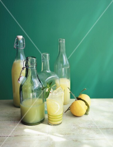 Lemonade in glass bottles and a glass