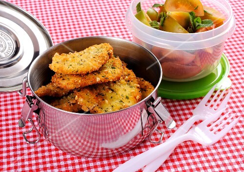 Chicken esclaopes in breadcrumbs with tomato & peppermint salad