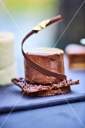 A chocolate dessert with nut brittle