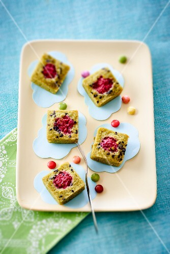 French financier cakes with colourful sugar-coated chocolates
