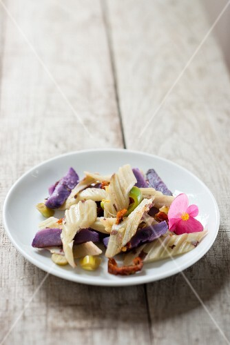 Cardoon with purple potatoes and dried tomatoes