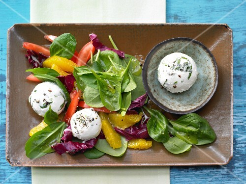 Wild garlic and cream cheese balls with orange and lamb's lettuce salad