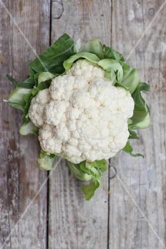 Cauliflower on a wooden background