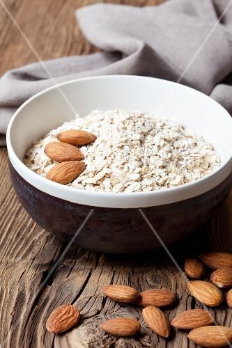 Porridge oats and almonds in a ceramic bowl