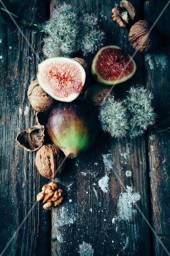 Fresh figs and walnuts on a wooden surface