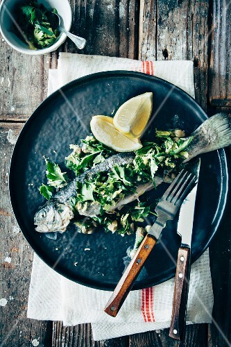 Poached trout with fresh lemon, capers and salsa verde