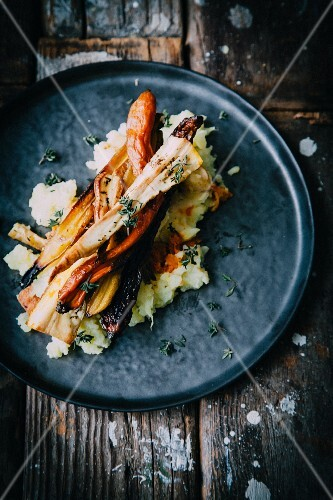 Mashed potato with roasted parsnips, carrots and fresh thyme