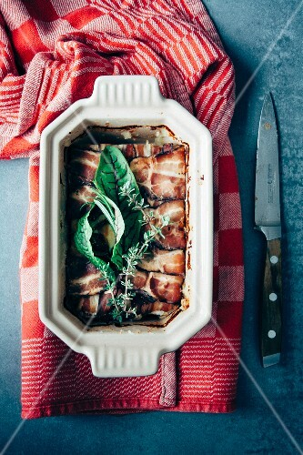 Home-made potato terrine with bacon and fresh herbs