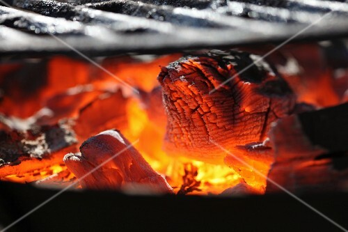 Glowing coals on a barbecue (close-up)