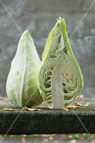 A pointed cabbage sliced in half