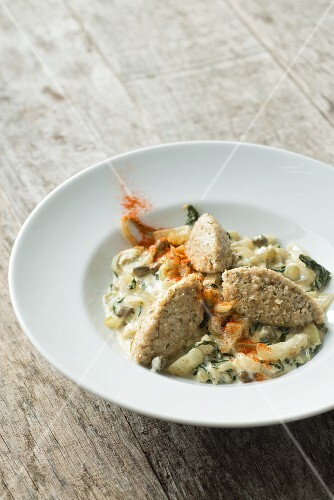Unripe spelt grain on a bed of chard with cream caper & sherry sauce