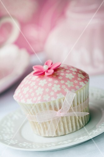 Cupcake decorated with patterned fondant and a sugar flower