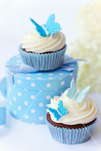 Chocolate cupcakes decorated with sugar butterflies