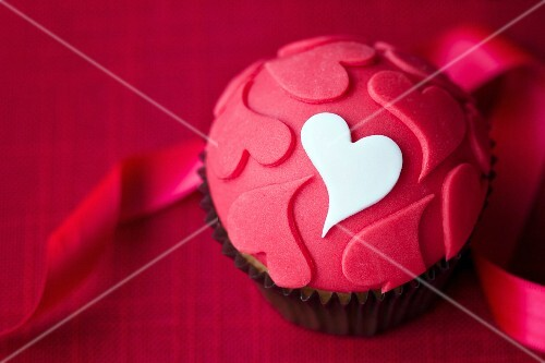 Cupcake decorated with fondant hearts