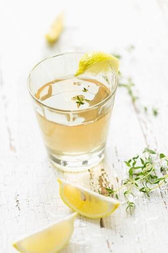 Home-made thyme syrup lemonade with lemon