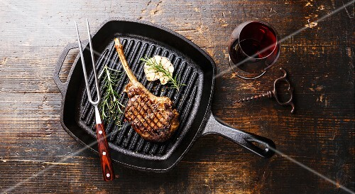 Grilled beef barbecue Veal rib Steak on bone on frying cast iron