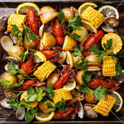 Clambake Seafood boil with boiled Crayfish, Corn on the Cob, Potatoes and Clams