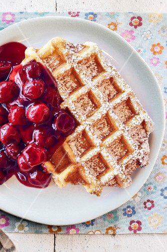 A waffle with cherries